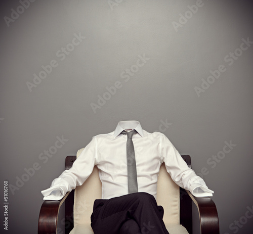 invisible man sitting on armchair