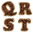 Alphabet from coffee beans on fabric texture isolated on white