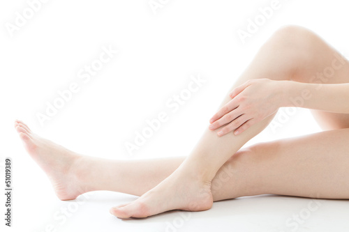 Beautiful young woman legs on white background