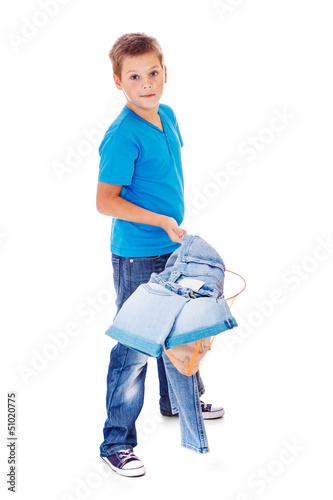 Boy with clothes pile