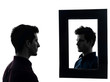man in front of his mirror silhouette