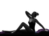 woman waking up stretching neckache in bed silhouette