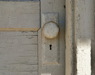 Old weathered door and knob