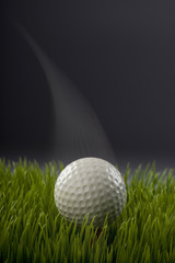 Golf ball showing motion.