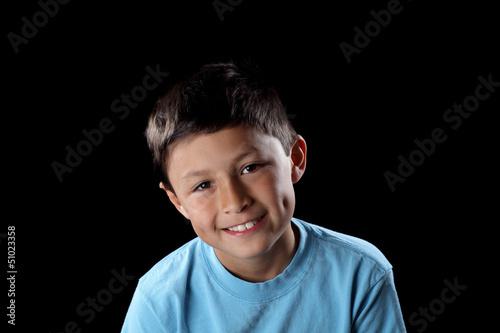 Smiling boy on black background