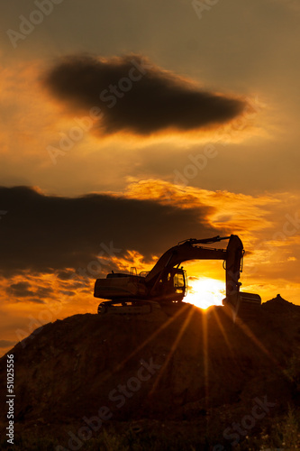 skyline excavator with colored sunset