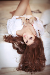 Brunette woman in bed in mornimg