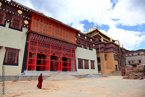 Tibetan monk is walking in Songzanlin Monastery in Zhongdian (Sh