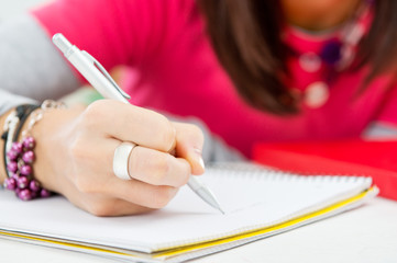 Closeup Of Girl Hand Writing