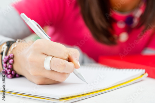 Closeup Of Girl Hand Writing