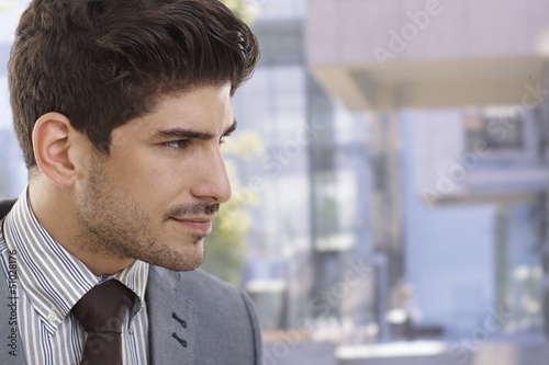Profile of handsome businessman outdoors