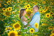 loving young couple in a field of sunflowers
