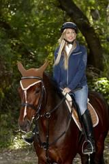 Pretty girl horseback riding