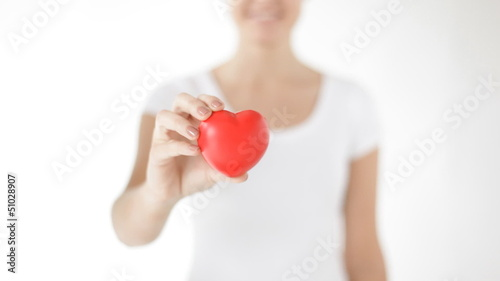 happy woman showing red heart