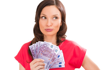 Woman holding and showing a lot of five hundred euro banknotes o
