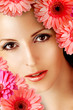 beautiful woman with gerbera flowers