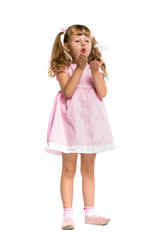 little girl blowing on a feather on a white background, isolated