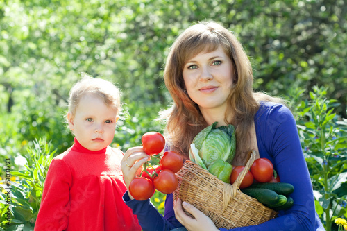 woman and baby with vegetables harvest
