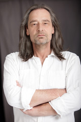 Serious man with shoulder length hair