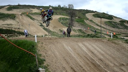 motocross competition, first lap