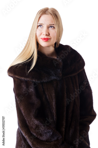 Tall model wearing fur coat