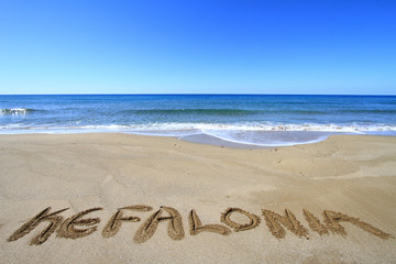 Kefalonia written on sandy beach