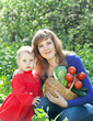 Happy woman and baby with vegetables
