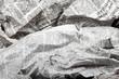 Leinwanddruck Bild background of old crumpled newspapers