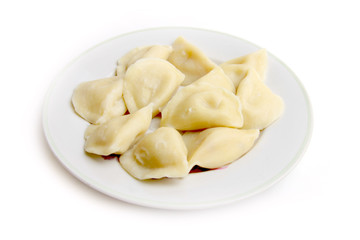 juicy dumplings to rest upon plate for presenting during meal