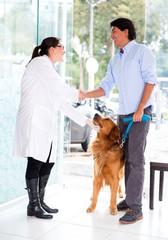 Man handshaking with the vet