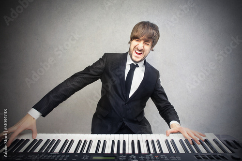 man playing pianoforte