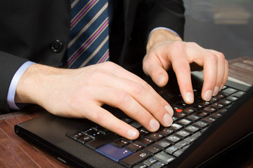 Businessman typing on a Personal Computer keyboard