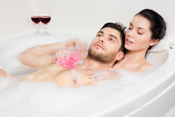 beautiful couple is taking a bath