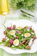 salad with quail eggs, feta and arugula, vertical, closeup