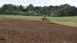 tractor plow field stork birds fly away