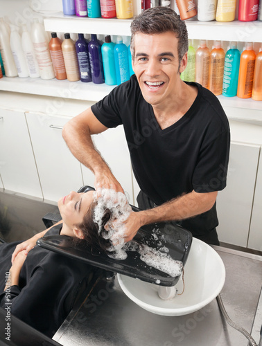 Hairstylist Washing Customer's Hair