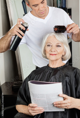 Hairstylist Setting Up Client's Hair At Salon