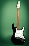 Retro electric guitar on green
