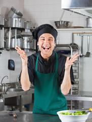 Male Chef Gesturing In Kitchen