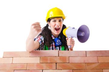 Woman with louspeaker near brick wall