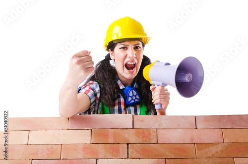 Woman with louspeaker near brick wall