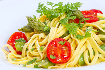 Tagliarini pasta with asparagus and cherry tomato