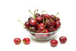 cherries in a glass bowl on a white background