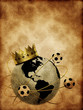 Soccer ball with crown and globe on the old texture