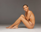 naked woman sitting on the floor