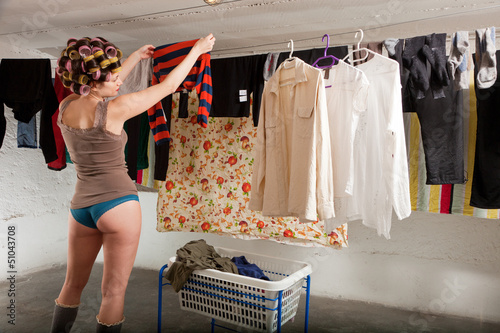 girl stretches the clothes in the room