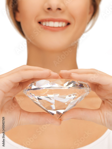 woman's hands showing big diamond