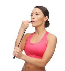 woman with whistle looking at something
