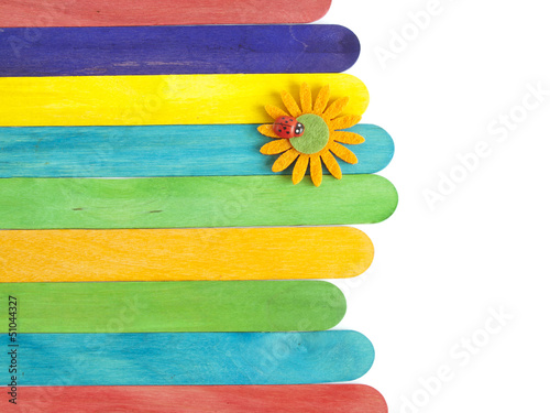 wooden fence with daisy flower and ladybug