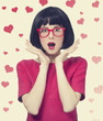 girl in red glasses at white background.